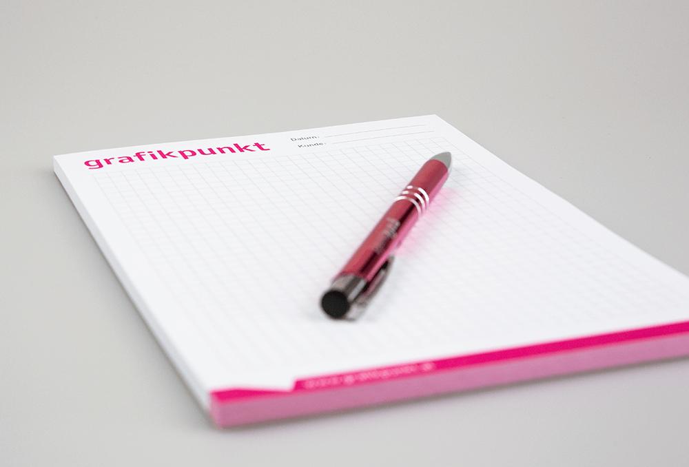 Grafikpunkt - Block und Kugelschreiber